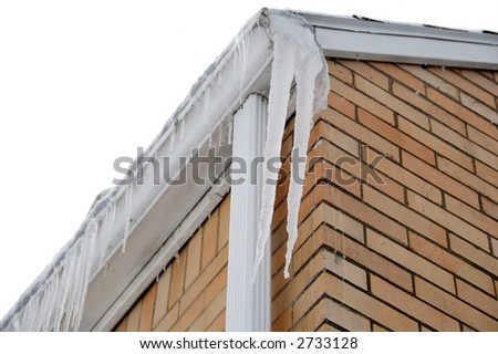 icicles hanging on house in winter - stock photo