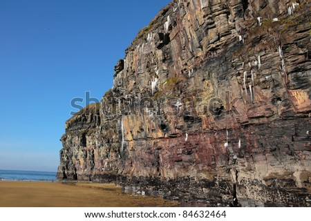 icicles on a cliff face on ballybunion beach in ireland on a winters morning