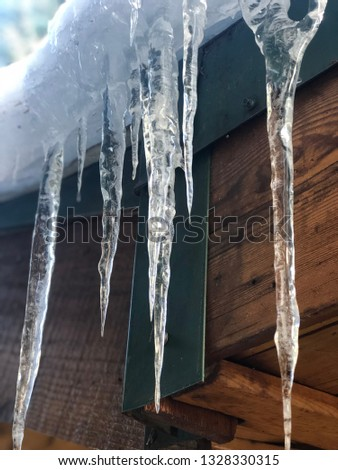 Icicles on a wintry cabin #1328330315