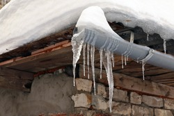 Icicles on the roof in a cold winter day
