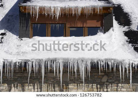 Icicles on the roof of a house in the Pyrenees, Canfranc Valley, Huesca, Aragon, Spain.