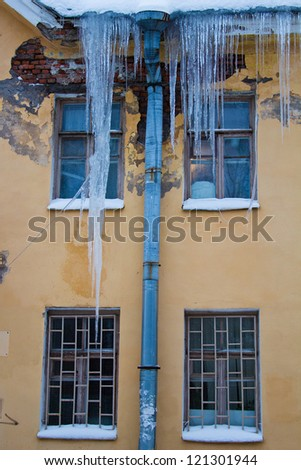 Icicles on the roof of the house