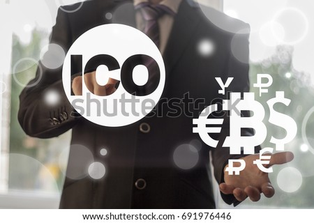 ICO - Initial Coin Offering Bitcoin Digital Electronic Binary Money Financial concept. Man presses currencies cloud button and offers ico icon on a virtual graphical user interface.