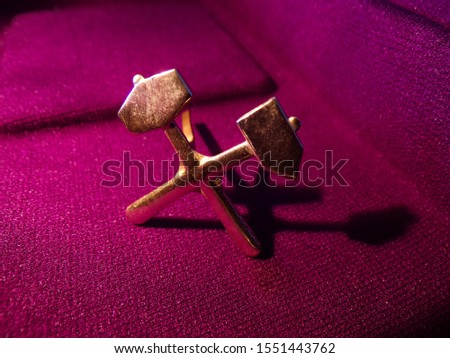 Icon of Soviet times mountain hammers. The buttonhole hammers are designed to be worn on a work uniform. #1551443762