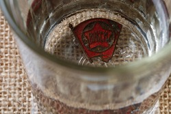 icon of the Komsomol in a glass faceted glass with vodka, joining the Komsomol in the Soviet era