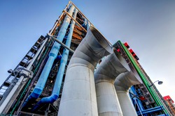Iconic architecture of Centre Pompidou featuring ventilation shafts and ductwork on the exterior