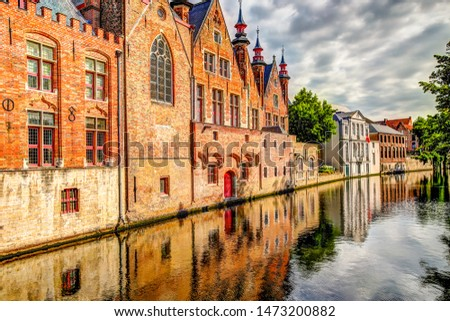 Iconic buildings along the canals of Bruges Belgium #1473200882