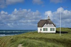iconic danish beach house on the coast of Denmark in Løkken