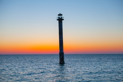 Iconic falling Kiipsaare lighthouse at sunset light, island of Saaremaa, Estonia.