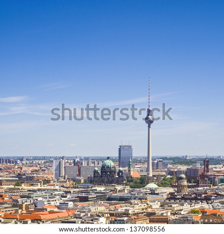 Iconic Fernsehturm television tower overlooking Berlin cityscape from a dizzying 1200 ft in the Alexanderplatz district.