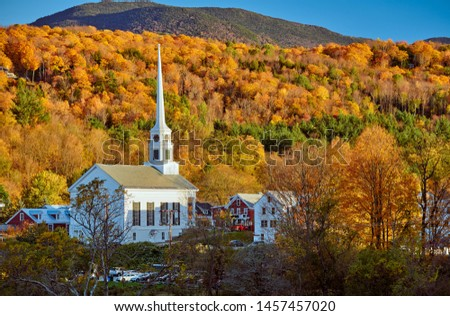 Iconic New England church in Stowe town at autumn in Vermont, USA  #1457457020