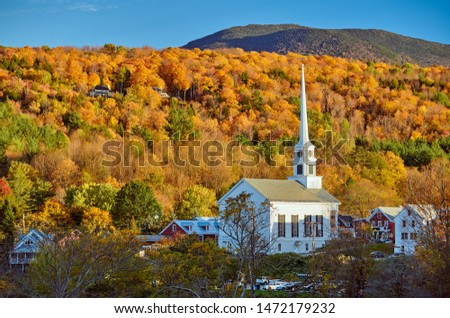 Iconic New England church in Stowe town at autumn in Vermont, USA  #1472179232