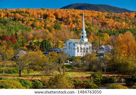 Iconic New England church in Stowe town at autumn in Vermont, USA  #1484763050