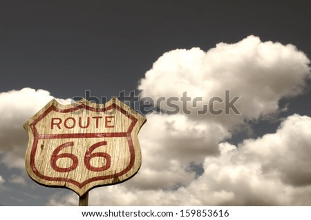 iconic route 66 sign framed by...