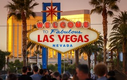 Iconic Sign Welcome to Fabulous Las Vegas in Nevada crowded by people waiting in a long line to pose with the sign and take a photo