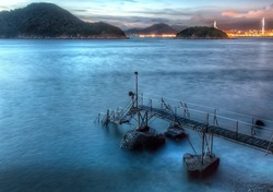 Iconic View of Sai Wan Swimming Pier and Shed at Dusk with Night Skyline in Kennedy Town, Hong Kong