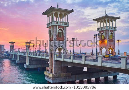 Iconnic Stanley Bridge boasts Islamic-styled towers, old-fashioned streetlights, this place is perfect for evening walks and opens great views on sunset sky over Mediterranean sea, Alexandria, Egypt.