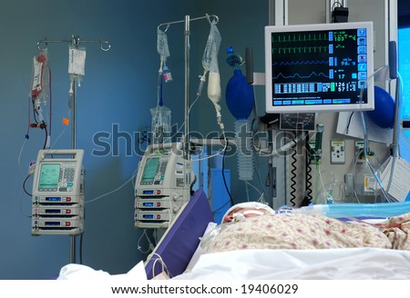 ICU room in a hospital with medical equipments and a patient
