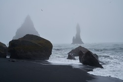 Icy beach in Iceland, Europe. Ice on the black volcanic sand on the Atlantic Ocean. Tourist attraction. Amazing landscape cloudy day. World beauty. 2020