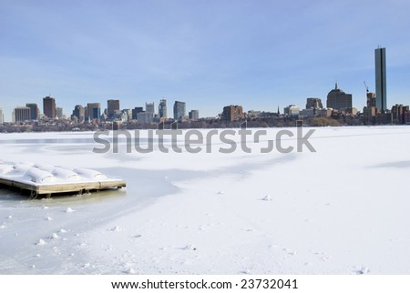 Icy charles river overlooking boston skyline in the winter - stock photo