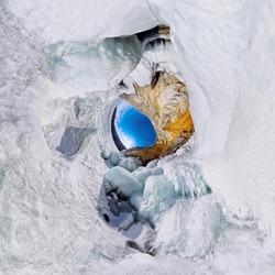icy rocks of Olkhon Island are Lake Baikal. little planet 360 panorama
