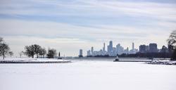 Icy shoreline Chicago skyline in winter