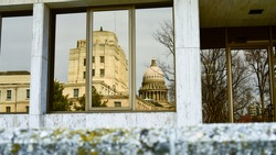 Idaho's capital reflection in a nearby window.