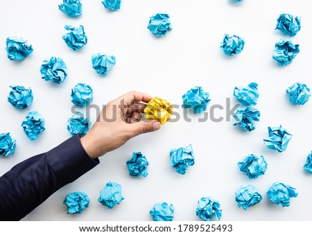Idea and creativity concepts with person choosing outstanding paper crumpled ball in mountain shap.Think out of box.Business solution. Foto d'archivio ©
