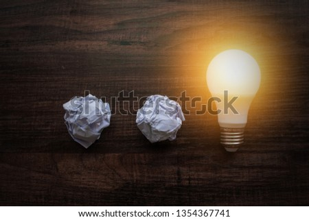 Idea and pure  bright energy concept, light bulb and paper