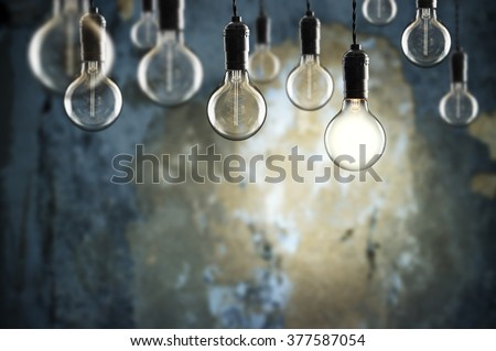 Idea and teamwork concept Vintage  bulbs on wall background,  copy space for text