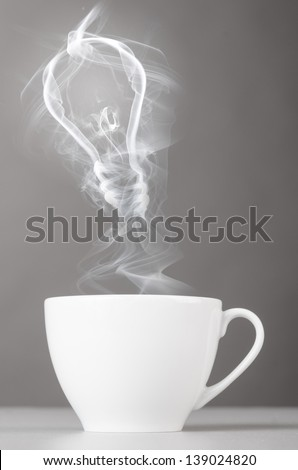 idea. bulb silhouette from steaming hot coffee cup