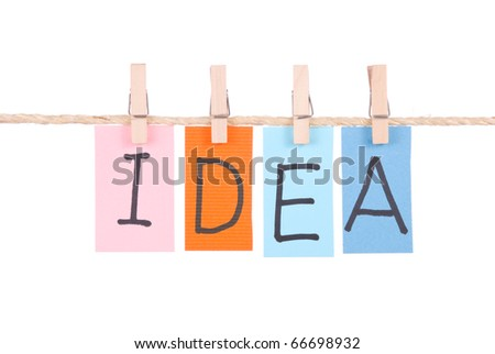 Idea, Colorful words hang on rope by wooden peg