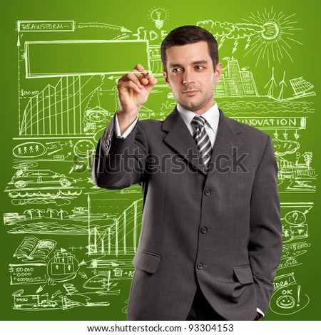 Idea concept, man businessman writing something on glass board with marker
