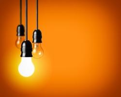 Idea concept on orange background.