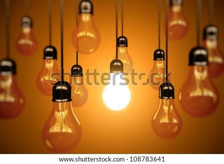 idea concept with light bulbs on a orange background