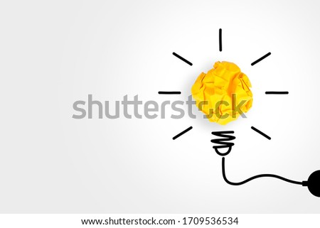 Idea Concepts with Light Bulb Crumpled Paper on White Background