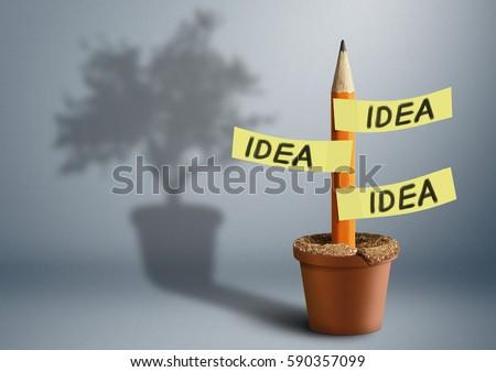 Shutterstock Idea creative concept, pencil with tree shadow