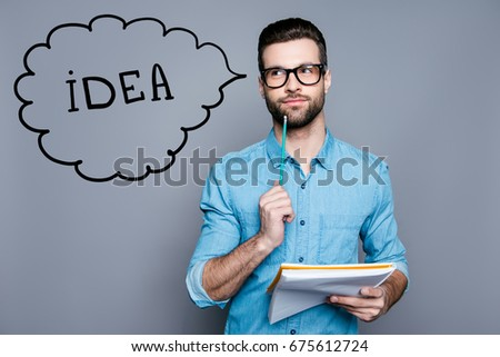 Idea imagination and inspiration concept. Nerdy academic professor genious is thoughtful, in glasses, holding a notebook and thinking about exams