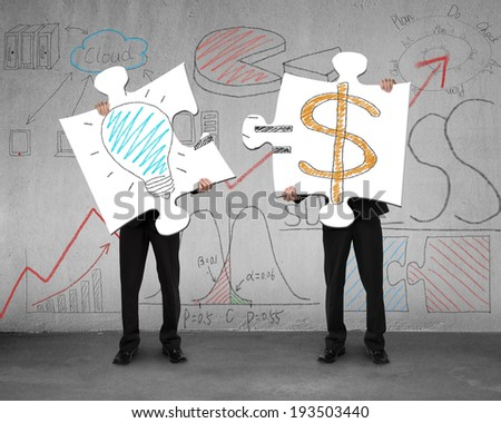 Idea is money concept on puzzles with men holding in office Stock photo ©
