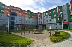 Ideal council estate, houses everyone would like to live in, with playground for kids, colorful, blue sky