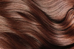 Ideal natural brown hair close up.