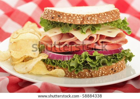 Ideal, perfectly stuffed sandwich with ham and Swiss cheese