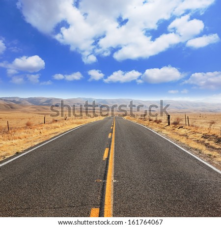 Ideal road. The magnificent equal highway through boundless to the desert