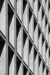 Ideal shadows on stone facade wall of modern minimal office building. Abstract modern business architecture photo. Geometrical pattern with polygonal and triangular elements in perspective.