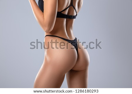 Ideal woman's fitness butt and hips - sport and perfect anti-cellulite and skin care therapy program.