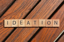 Ideation, business buzzword in wooden alphabet letters on teak background