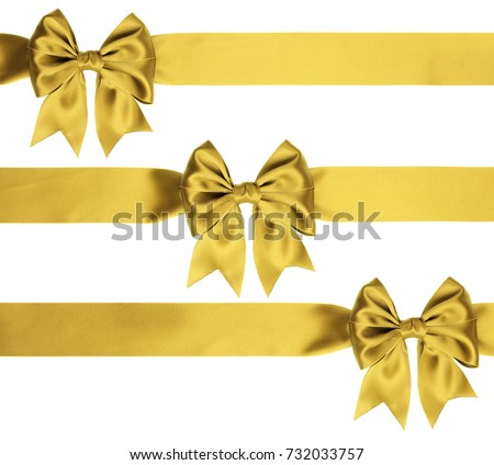 Identical golden bows on a ribbon for various ornaments on white background