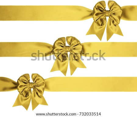 Identical golden bows with tails on a ribbon for various ornaments isolated on white background