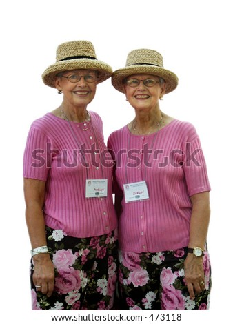 Identical twin ladies in straw hats