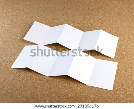 identity design, corporate templates, company style, set of booklets, blank white folding paper flyer on a cork background